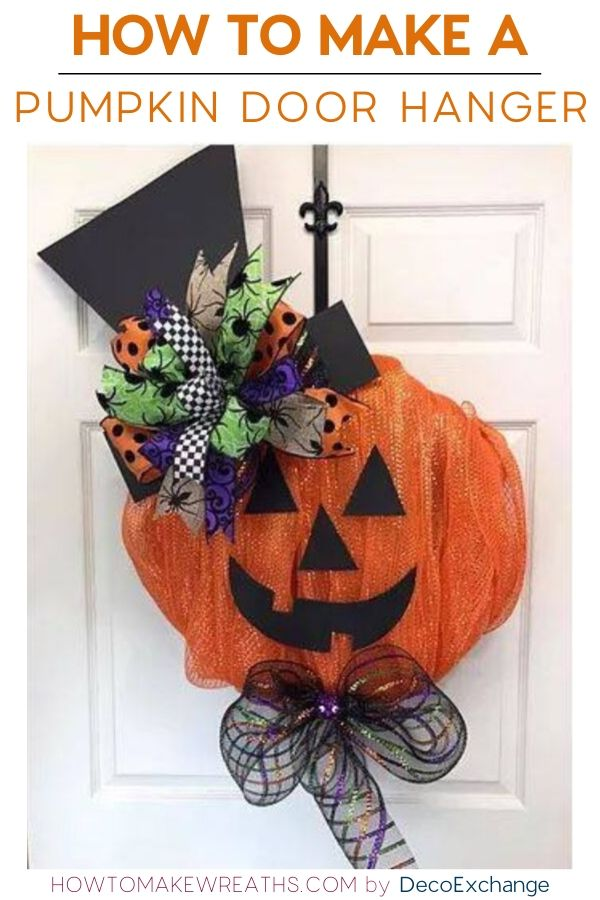 DIY Pumpkin door hanger with a purple and green ribbon on top