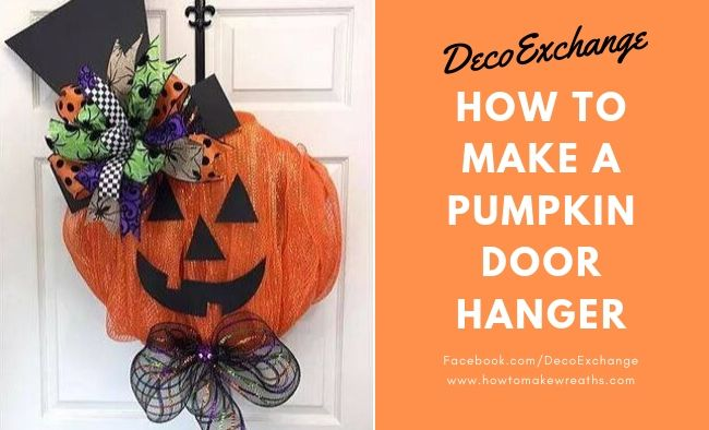 pumpkin door hanger with top hat on a white door