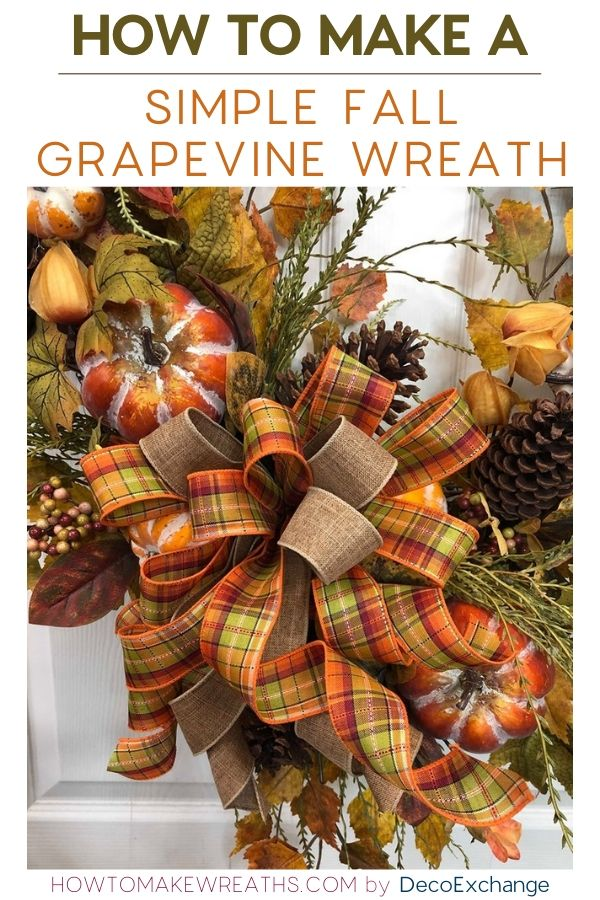 Fall grapevine wreath decorated with plaid bows, pumpkins, and pinecones.