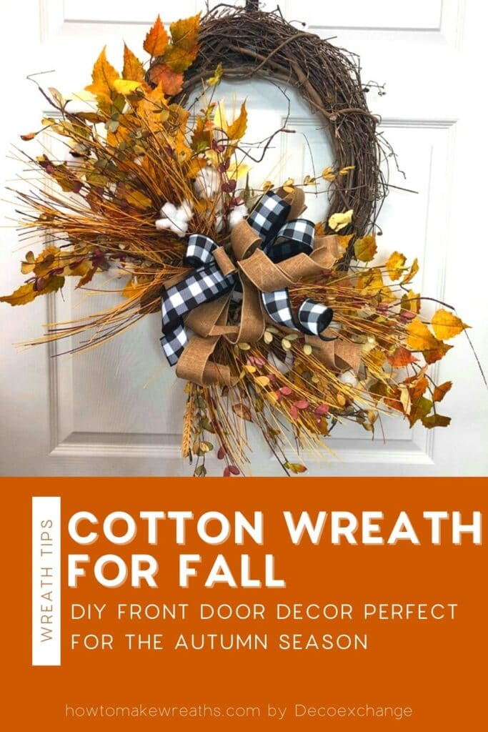 black, white, and burlap bow, cotton stems, autumn leaves on a grapevine wreath