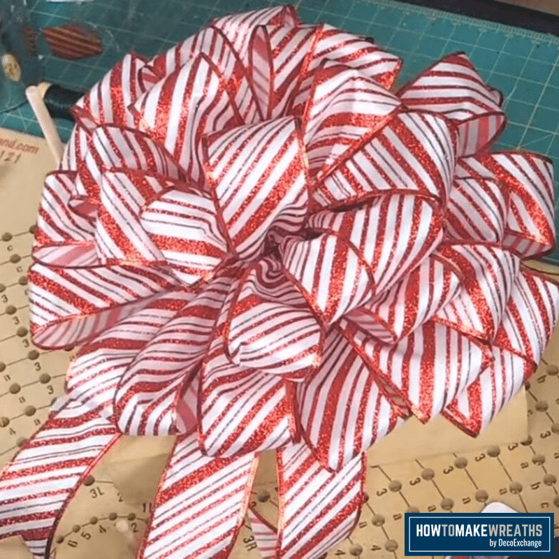 red and white striped Christmas tree bow topper