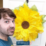 Damon with a completed DIY Sunflower wreath