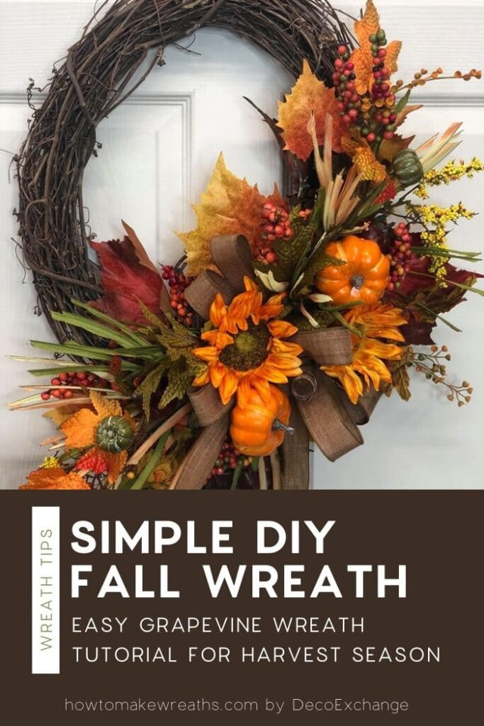 Oval grapevine wreath with fall foliage and pumpkins