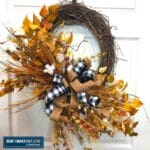 fall leaves, cotton stem, bow, grapevine wreath base