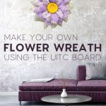 flower wreath in living room with purple couch