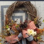 red and blue bow, florals on grapevine wreath