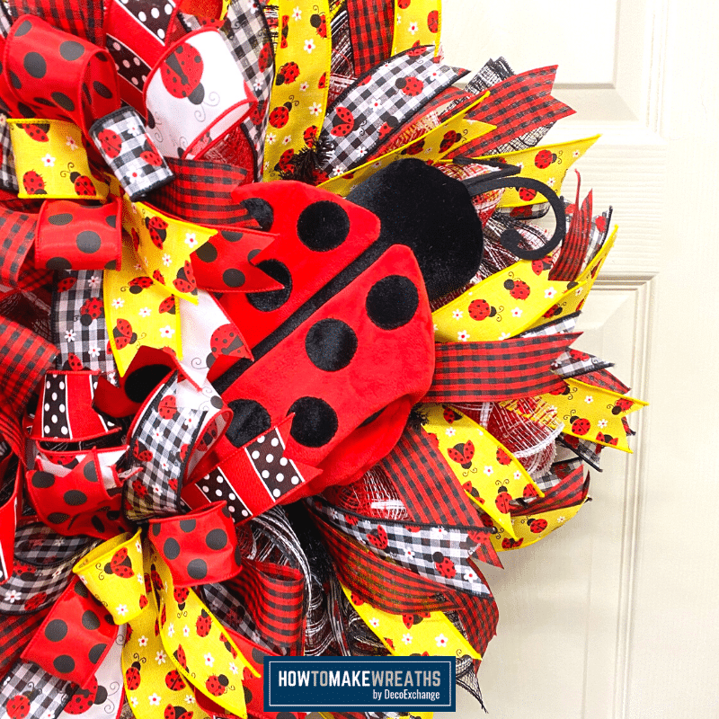 stuffed ladybug with ribbon