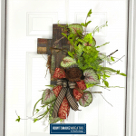 cross, greenery, grapevine, bow