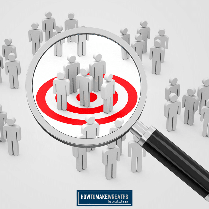 magnifying glass focusing in on a red target to signify target audience
