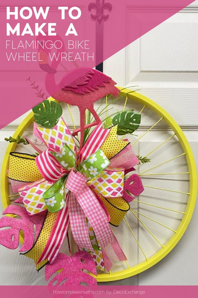 yellow bike wheel with pink bow