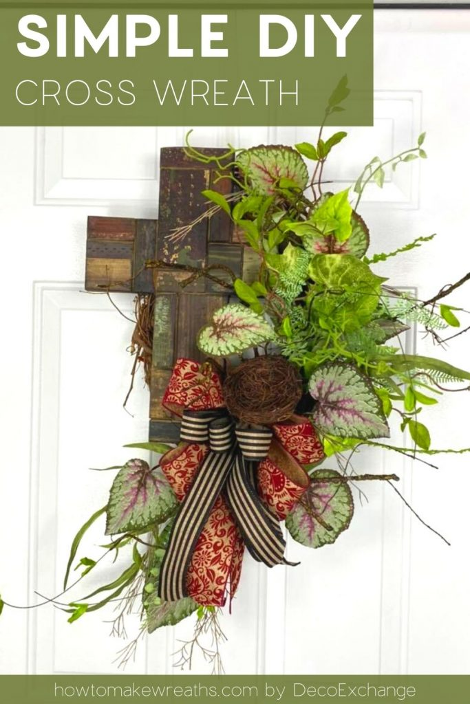 red, black, and tan bow, cross, greenery