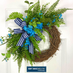 navy and white stripe bow on blue floral grapevine wreath