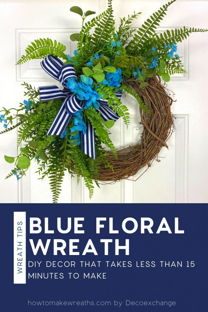 grapevine wreath with blue florals, greenery, and blue and white stripe bow