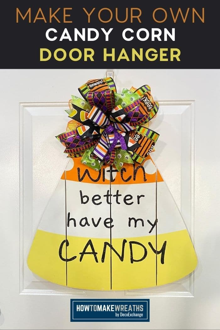 purple, green, and orange bow on a candy corn sign