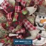 wooden snowman attachment on a burlap wreath