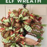 Christmas ribbon and mesh with elf sign on a wreath on a front door