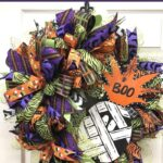 purple, green, and orange bows, mesh wreath with mummy sign