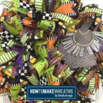 halloween colored ribbon and mesh wreath with witch and broom attachments