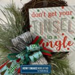 Don't Get Your Tinsel in a Tangle sign on a grapevine wreath