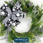 Black and White bow on evergreen wreath