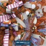 orange, pink, and striped ribbons with wooden easter bunny welcome sign