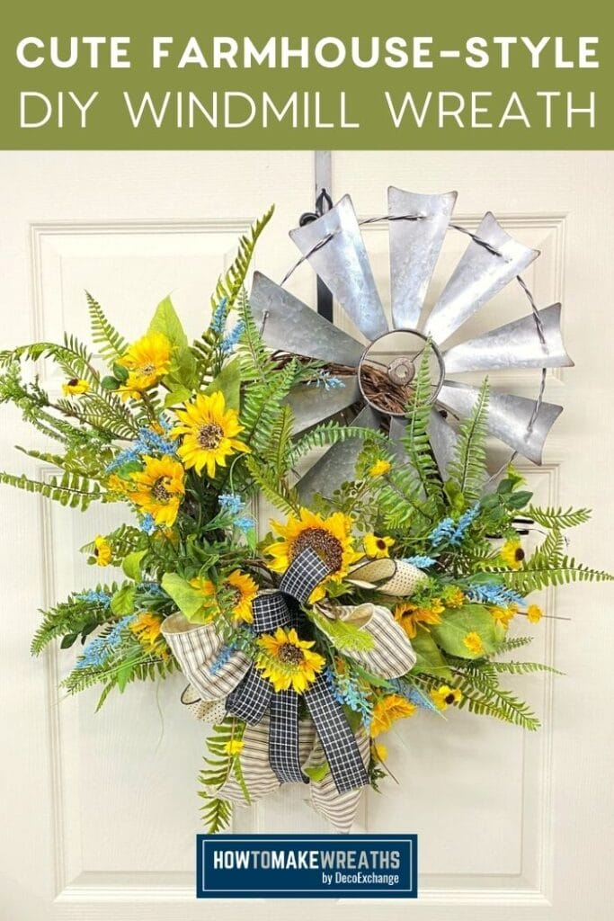 windmill blades, greenery, sunflowers, and brown and black bow on a grapevine wreath