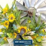 sunflowers and greenery on a windmill grapevine wreath